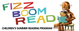 A kid sits on the lap of a robot holding a book and reading. The words fizz boom read children's summer reading program are next to them